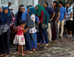 Maldivians living in Sri Lanka stand in line to cast their vote during the Maldives presidnetial election day at the Maldives embassy in Colombo