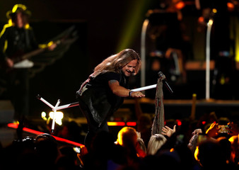 Lead vocalist Johnny Van Zant of Lynyrd Skynyrd reaches out to a fan during the iHeartRadio Music Festival at T-Mobile Arena in Las Vegas