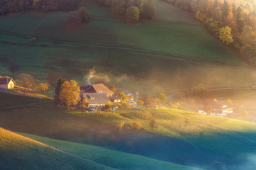 Scenic autumn mountain landscape. Rolling hills in Schwarzwald, Germany. Colorful dreamy travel background.