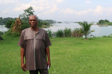 Chief Michael Porobunu, chairman of Gokana council of chiefs, stands outside his house in the village of Bodo in the Niger delta