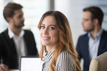 Portrait of beautiful smiling female worker or company manager looking at camera posing, pretty woman partner headshot picture during corporate meeting or negotiations in office