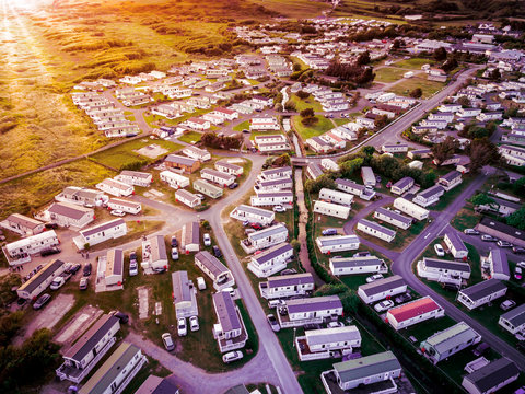 Sun set at a Caravan and camping park, static home aerial view. Porthmadog holiday park taken from the air by a drone