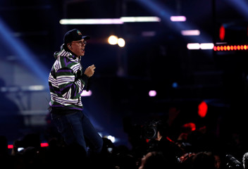 Logic performs during the iHeartRadio Music Festival at T-Mobile Arena in Las Vegas