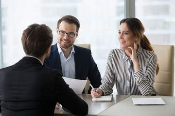 Smiling diverse HR managers satisfied about male job employee, have positive first impression of candidate, happy employers listen to applicant at interview excited of candidature. Recruitment concept