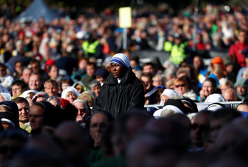 Faithful attend a Holy Mass celebrated by Pope Francis in Kaunas