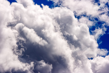 dense and great white clouds on a beautiful summer blue sky