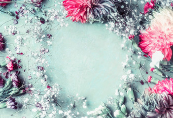 Wall Mural - Floral frame background with romantic flowers on light blue with pink , top view