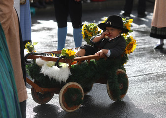 A child dressed in historical clothes takes part in Oktoberfest parade in Munich