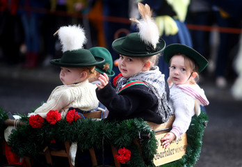 Chldren dressed in historical clothes take part in Oktoberfest parade in Munich