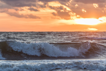 Sea wave and sunset