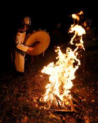 Khakassian shaman Kochitaeva leads a ritual devoted to the autumn equinox with a group of people in the Siberian taiga in Krasnoyarsk region