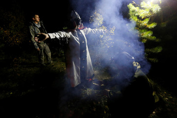 Khakassian shaman Kochitaeva leads a ritual devoted to the autumn equinox with a group of people in the Siberian taiga in Krasnoyarsk region