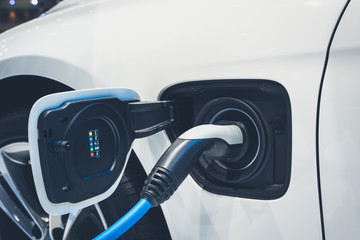 The process of charging an electric vehicle. Electric car socket for background