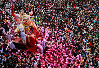 Devotees carry an idol of Hindu god Ganesh during a procession on the last day of the Ganesh Chaturthi festival, before immersing the idol into the Arabian sea, in Mumbai