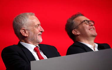 Britain's Labour Party Leader Jeremy Corbyn and Deputy Leader of the Labour Party Tom Watson sit together on stage at the annual Labour Party Conference in Liverpool