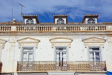 Traditional Portuguese building with dormer windows along the Av Da Republica, Vila Real de Santo Antonio, Algarve, Portugal.