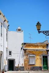 Traditional Portuguese buildings along the Rua do Minicipio in the old town part of the city, Faro, Algarve, Portugal.