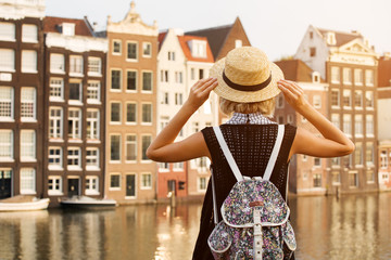 Travel in Amsterdam. Beautiful woman on vacation in Amsterdam city