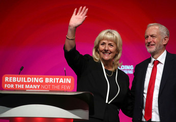 Britain's General Secretary of the Labour Party Jennie Formby is joined by Labour Party leader Jeremy Corbyn on stage at the annual Labour Party Conference in Liverpool