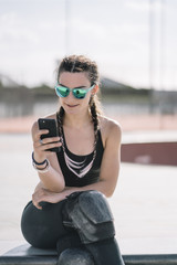 Brunette woman with sunglasses and mobile phone.