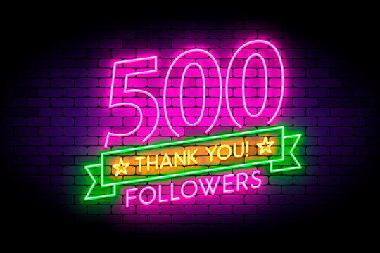 500 followers neon sign on the wall.