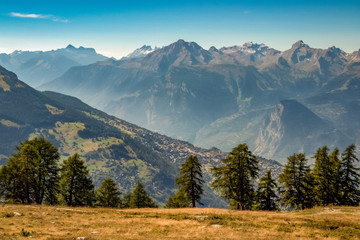 The evening sun is setting on the majestic mountains near the Rhone Valley in late september (Valais, Switzerland)