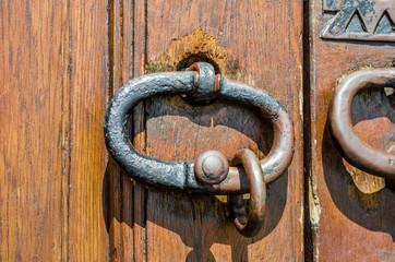 Heavy Copper Metal Handles on an Old Wooden Door