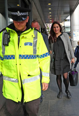 Labour MP Luciana Berger leaves a fringe meeting organised by the Jewish Labour Movement at the annual Labour Party Conference, accompanied by police protection, in Liverpool