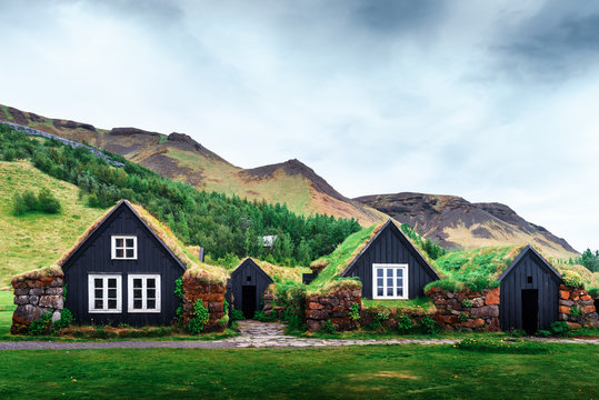 Traditional houses with grass on roof in Iceland. Landscape photography