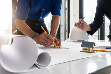 Image of engineer meeting for architectural project. working with partner and engineering tools on workplace.