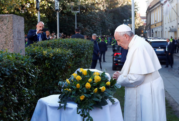 Pope Francis holds a silent prayer at the Memorial to the Holocaust victims, in Vilnius