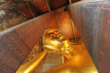 Wat Pho (the Temple of the Reclining Buddha), one of the largest temple complexes in the city and famed for its giant reclining Buddha that measures 46 metres long and is covered in gold leaf.