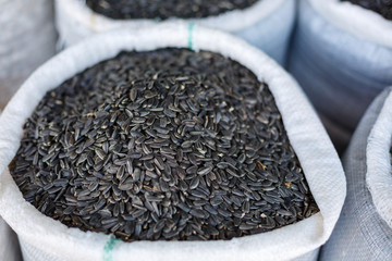 black sunflower seeds in a bag close-up