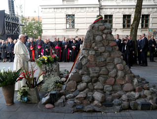 Pope Francis stands next to a memorial at the Museum of Occupations and Freedom Fights, in Vilnius