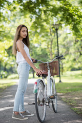 Portrait of Asian woman  with bike in park