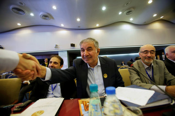 Iran's OPEC governor Hossein Kazempour Ardebili  is greeted at the OPEC Ministerial Monitoring Committee in Algiers