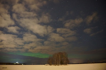 Lake-view at winter-night with island and northern lights
