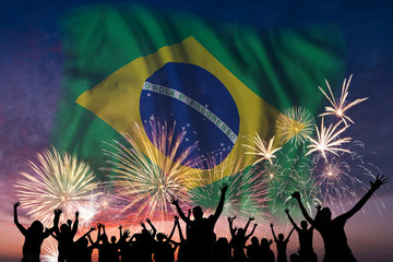 People are looking on fireworks and flag of Brazil