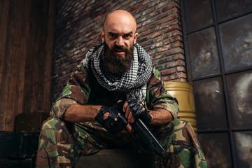 Bearded terrorist in uniform