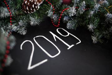 Inscription Happy New Year on black board. Black board with hand inscription Happy New Year with chalk.