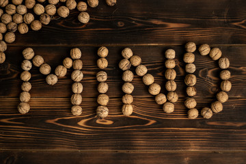 Mind inscription made from walnuts on a wooden background