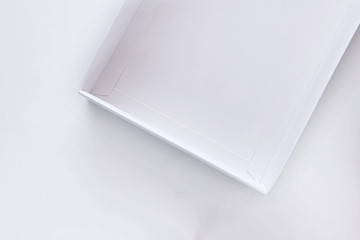 Top view of white empty open gift box on white background, holiday and event concept. Copy space for text