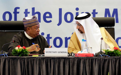 Saudi Arabian Energy Minister Khalid al-Falih talks with OPEC Secretary-General Mohammed Barkindo during the inaugural session ceremony of the OPEC Ministerial Monitoring Committee in Algiers