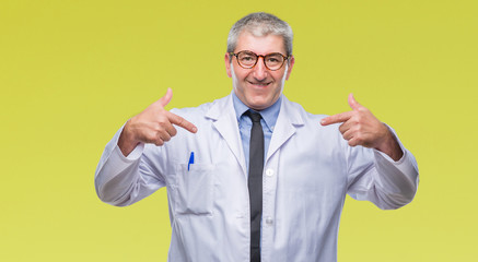 Handsome senior doctor, scientist professional man wearing white coat over isolated background looking confident with smile on face, pointing oneself with fingers proud and happy.