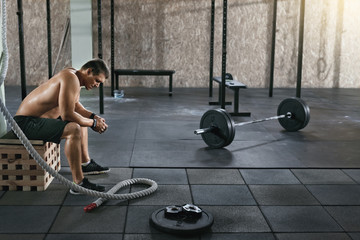 Gym. Sportsman At Functional Training With Barbell Row Wall mural