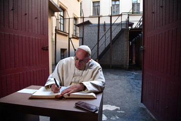 Pope Francis writes a message in the visitor's book at the Museum of Occupations and Freedom Fights, in Vilnius