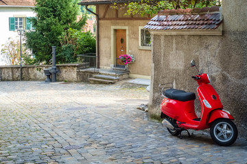 In a part of the old town of the Swiss city of Thun, a lonely red scooter is waiting to be used