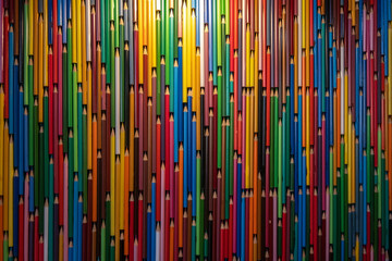 Colorful pencil background. Many multicolored pencils pattern texture