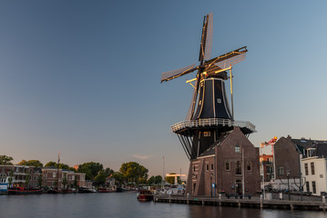 Dutch windmill, in the town of Haarlem, at sunset.
