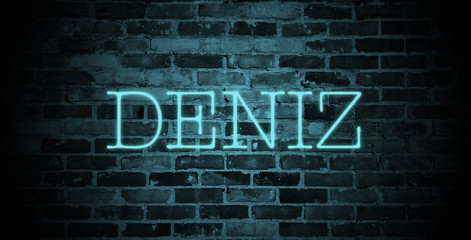 first name Deniz in blue neon on brick wall